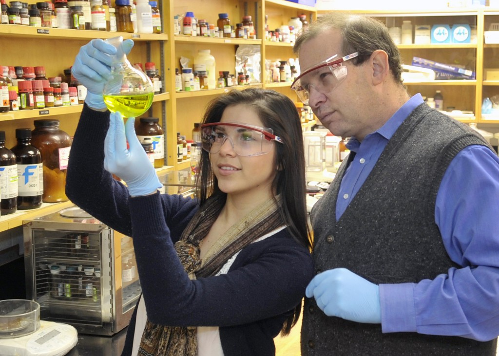 Rabinovich with student in lab