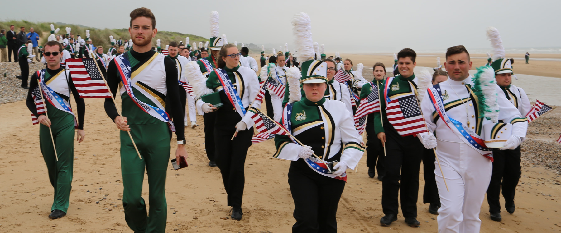 band students on the beach