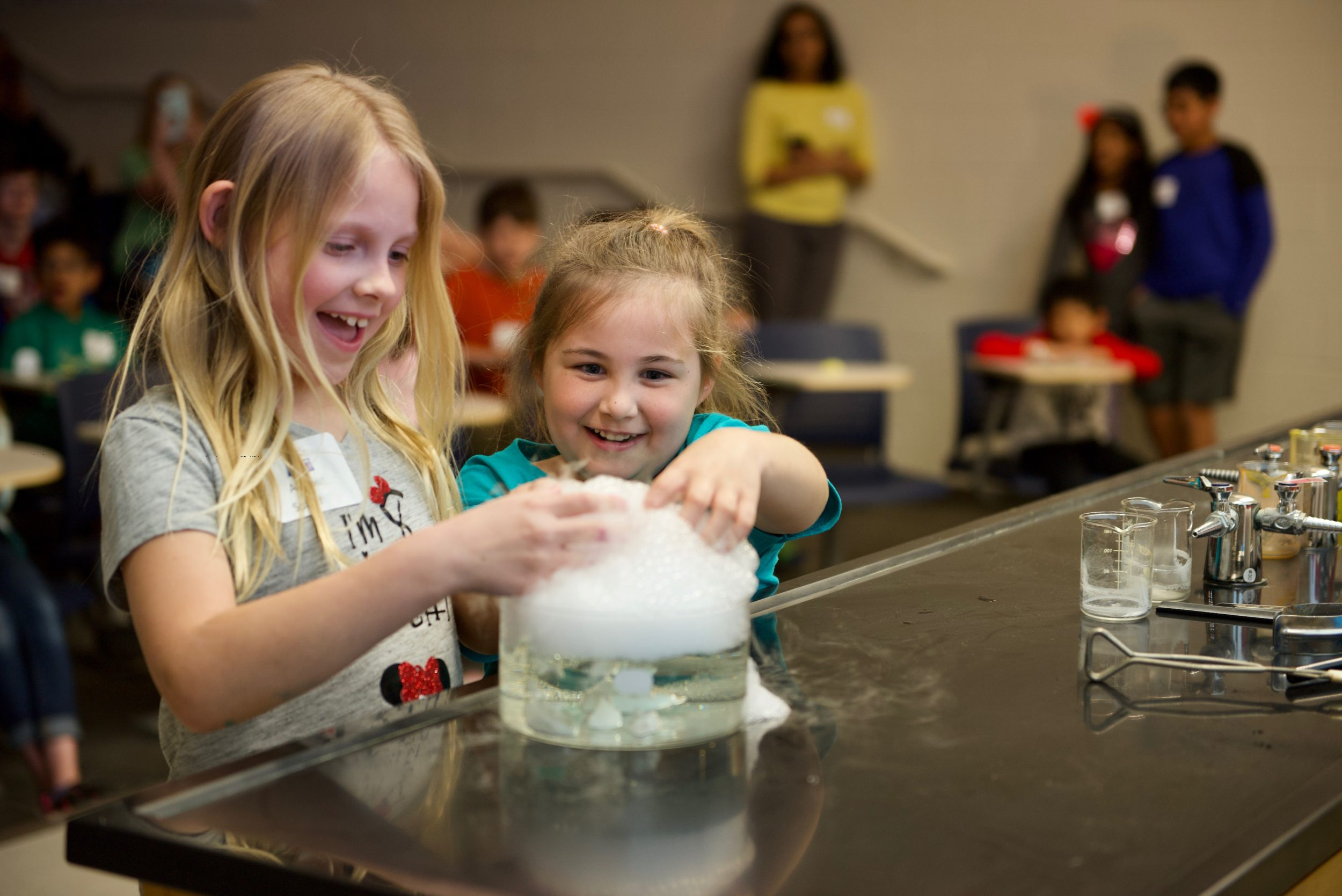 Children doing science experiments with bubbles